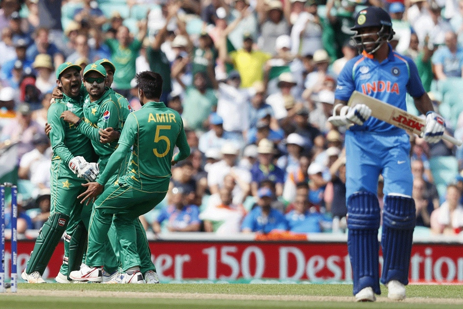 Pakistan celebrate the wicket of Shikhar Dhawan