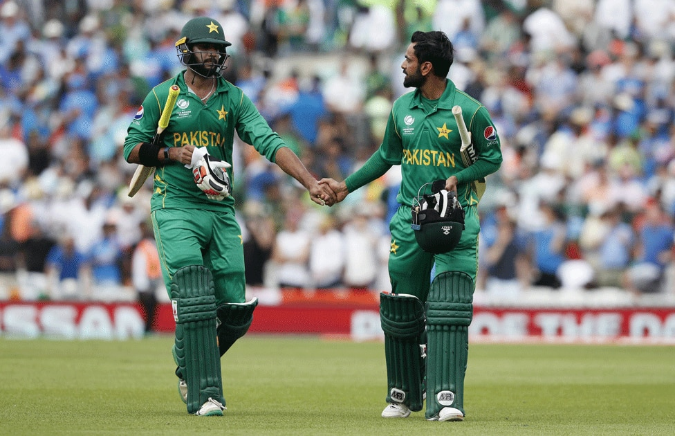 Mohammad Hafeez and teammate Imad Wasim walk from the field
