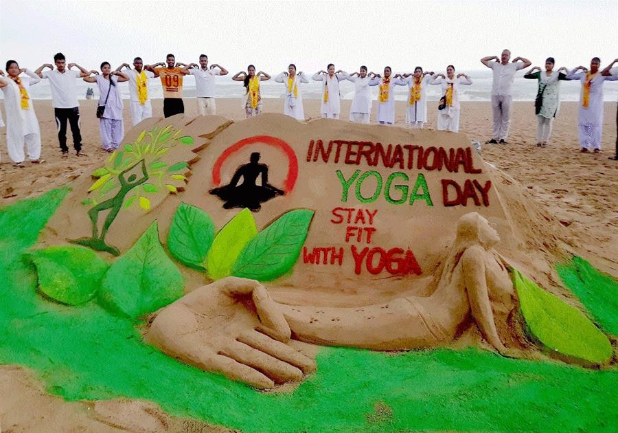 People practice yoga at Puri beach in Odisha
