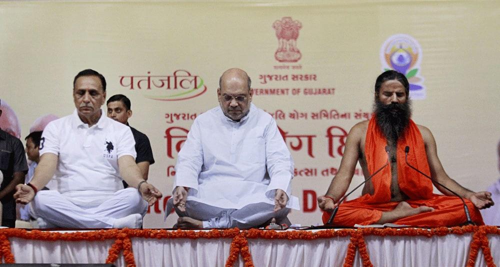 Amit Shah, Gujarat CM Vijay Rupani and Yoga guru Baba Ramdev perform Yoga