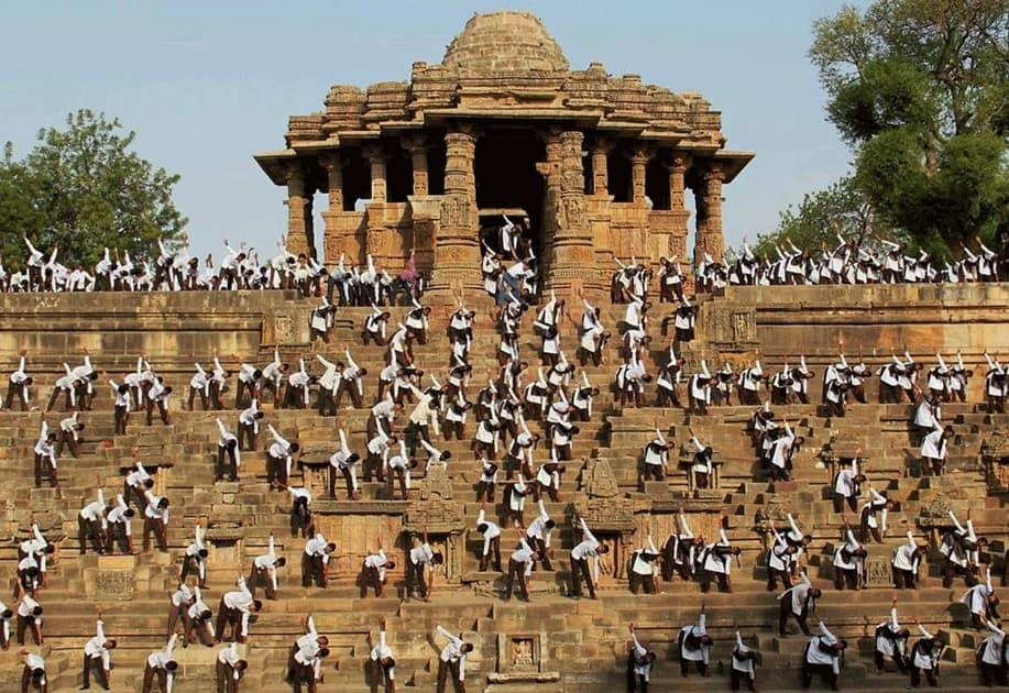 School Children perform yoga