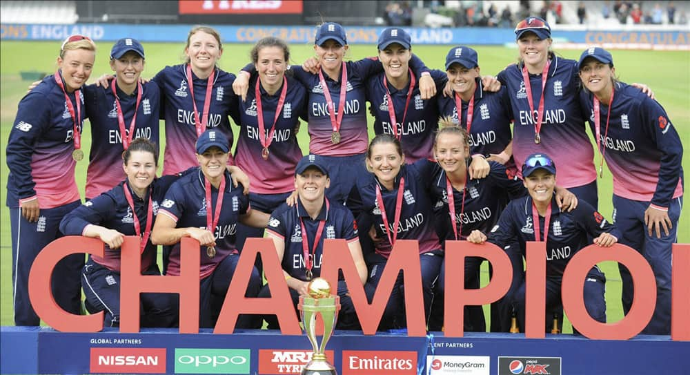 England players pose with the trophy