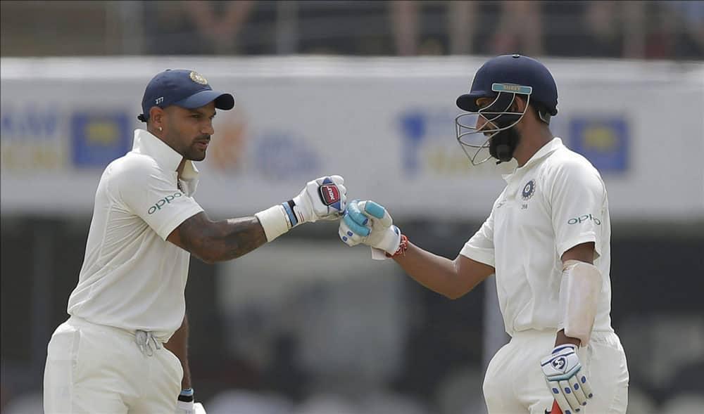 Cheteshwar Pujara and Shikhar Dhawan cheer at each other