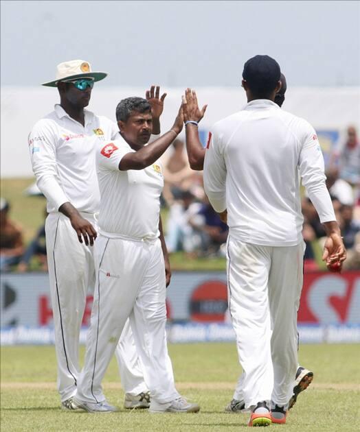Rangana Herath celebrates fall of a wicket