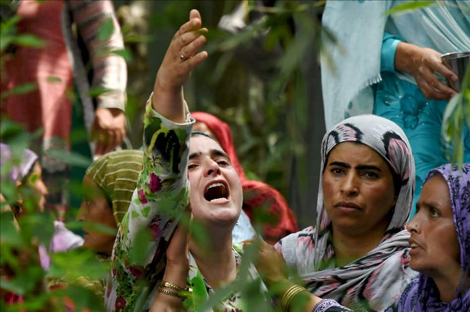 A woman crying during the funeral procession of a civilian