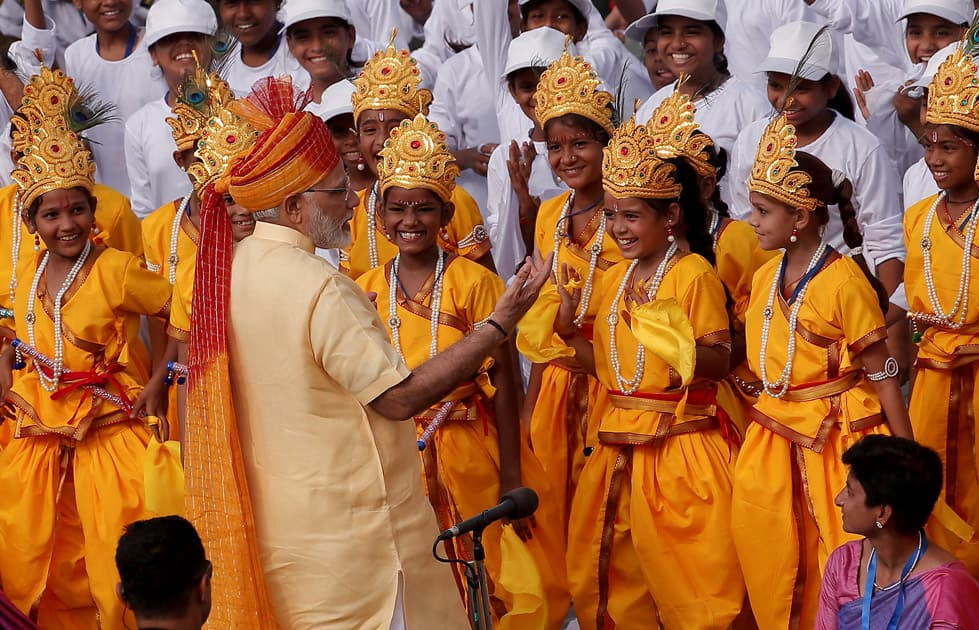 Prime Minister Modi greets school girls dressed as Hindu Lord Krishna