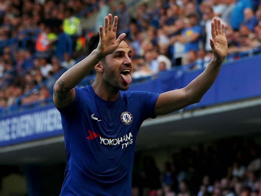 Chelsea player Cesc Fabregas celebrates after scoring the opening goal in their 2-0 win over Everton.