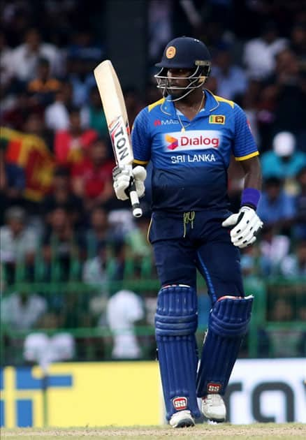 Sri Lanka's Angelo Mathews celebrates his half century