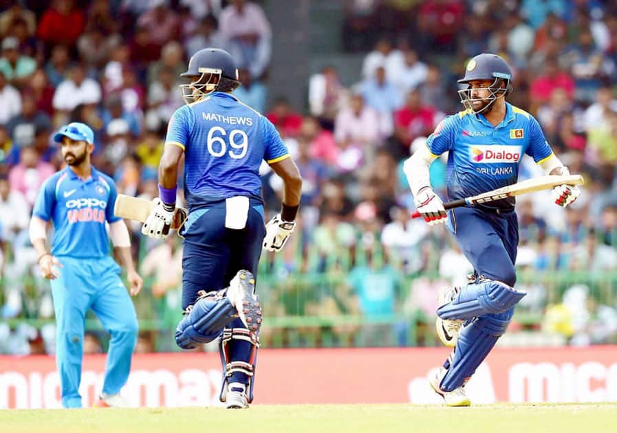 Sri Lankan batsman Lahiru Thirimanne and Angelo Mathews take a run