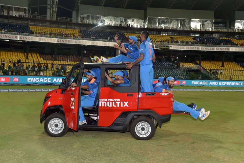 India's Mahendra Singh Dhoni drive a vehicle