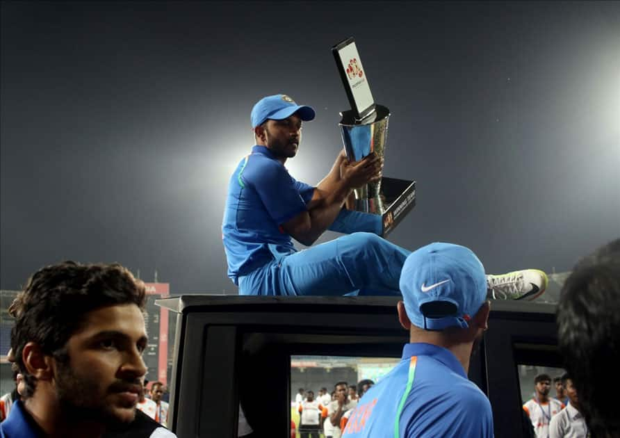 Indian cricket team enjoying a ride on a vehicle after winning