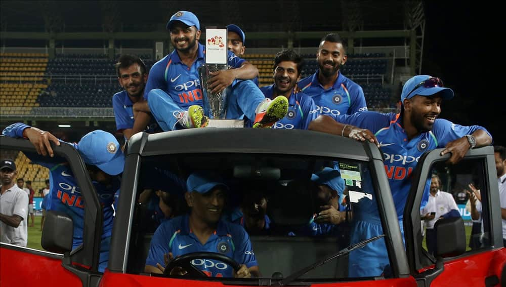 Indian cricketer MS Dhoni driving a vehicle