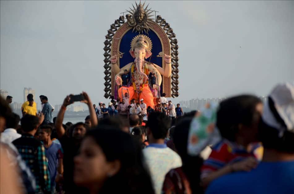 Ganesh immersion underway at Girgaum sea beach in Mumbai.