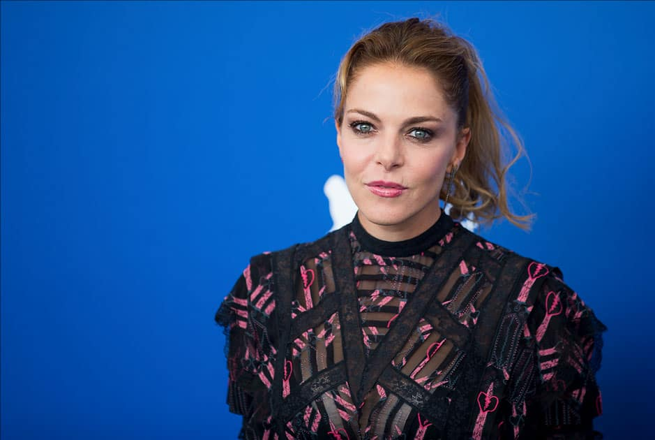 Actress Claudia Gerini poses during a photocall