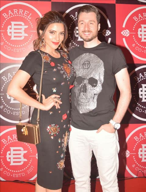 Actress Shama Sikander aand James Milliron during the launch Party of