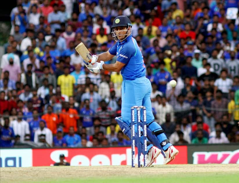MS Dhoni in action during the first ODI cricket match between India and Australia
