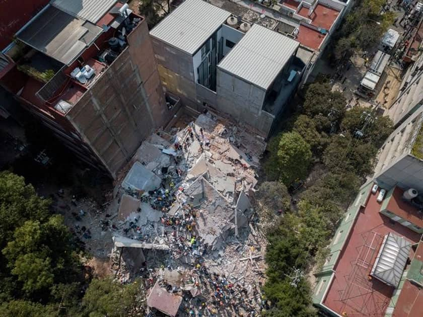 Search and rescue operations are carried out at the site of a collapsed building after an earthquake in Condesa, Mexico City