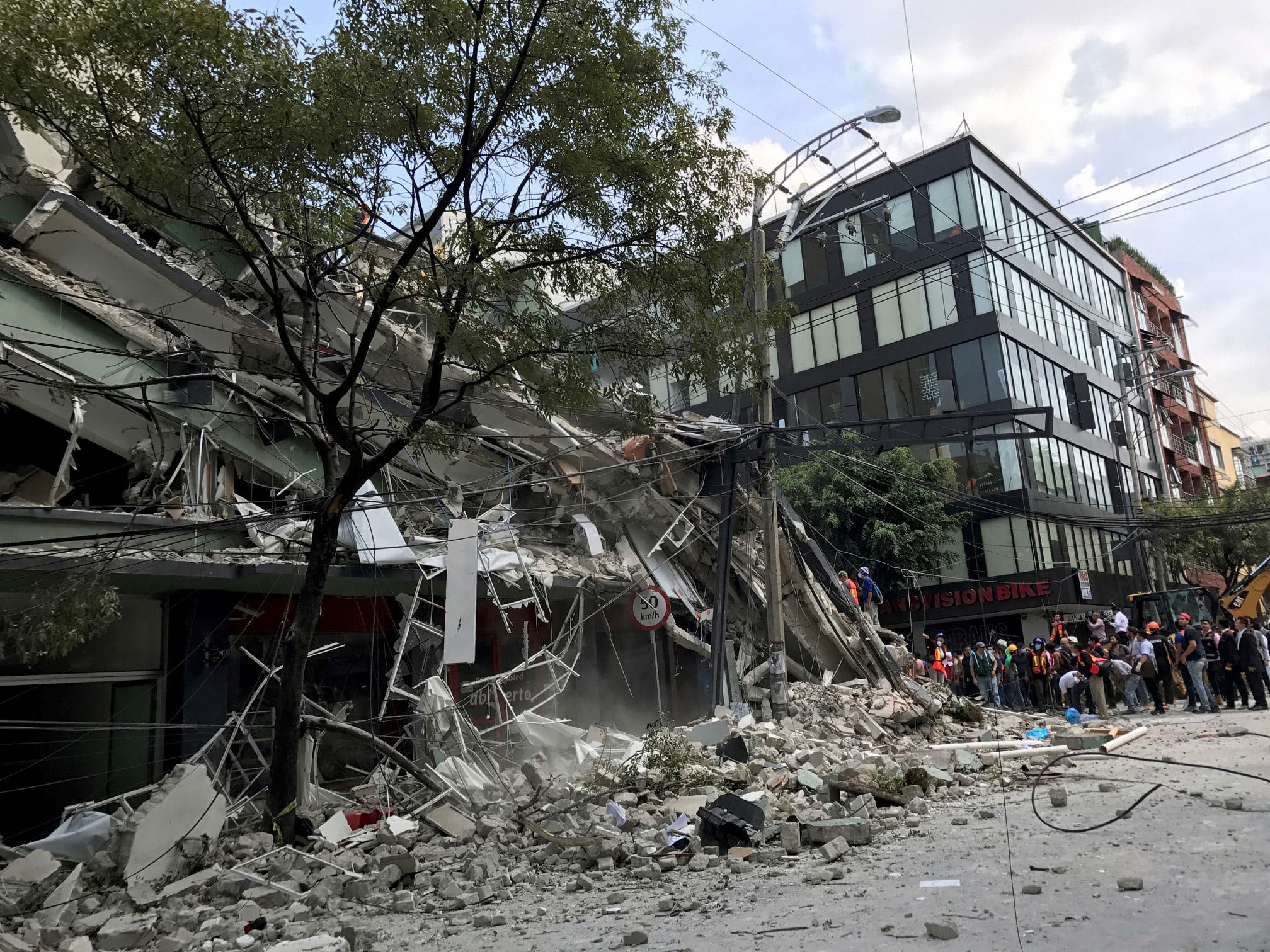 A collapsed building is seen after an earthquake hit in Mexico City, Mexico