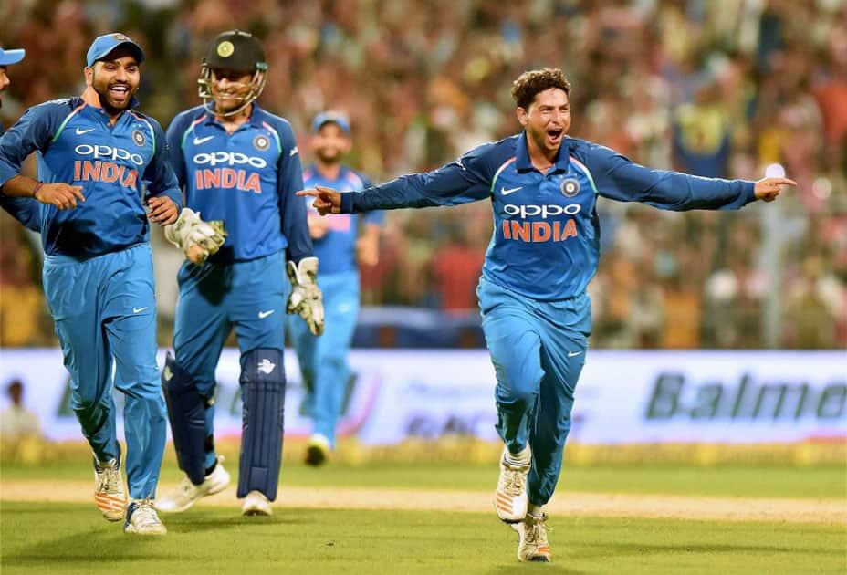 India's bowler Kuldeep Yadav celebrates his hat trick against Australia during 2nd ODI cricket match at Eden Garden in Kolkata.