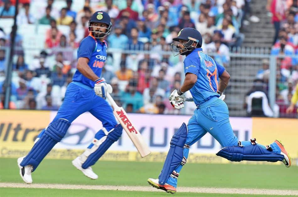 Indian captain Virat Kohli and Kedar Jadhav take a run during the 2nd ODI cricket match against Australia at Eden Garden in Kolkata