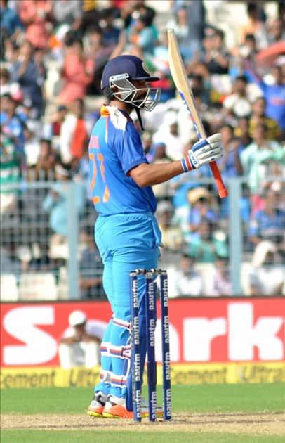 India's Ajinkya Rahane celebrates his half century during the second ODI cricket match between India and Australia at Eden Gardens in Kolkata.