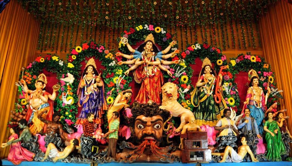 People throng the Durga pandal at Md. Ali Park in Kolkata.