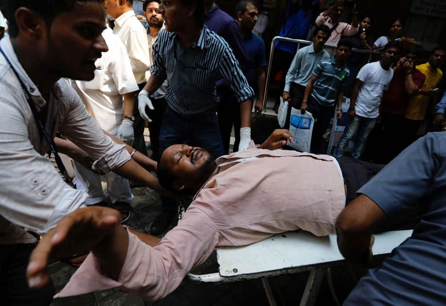 A stampede victim is carried on a stretcher at a hospital in Mumbai.