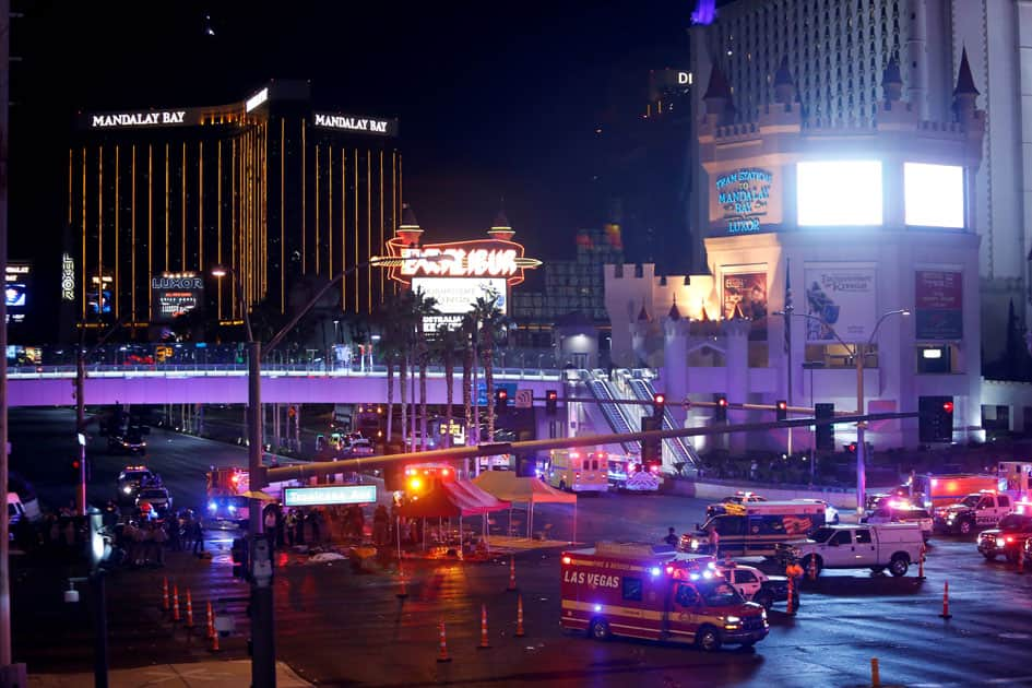 Las Vegas Metro Police and medical workers stage in the intersection of Tropicana Avenue and Las Vegas Boulevard South after a mass shooting at a music festival on the Las Vegas Strip in Las Vegas.