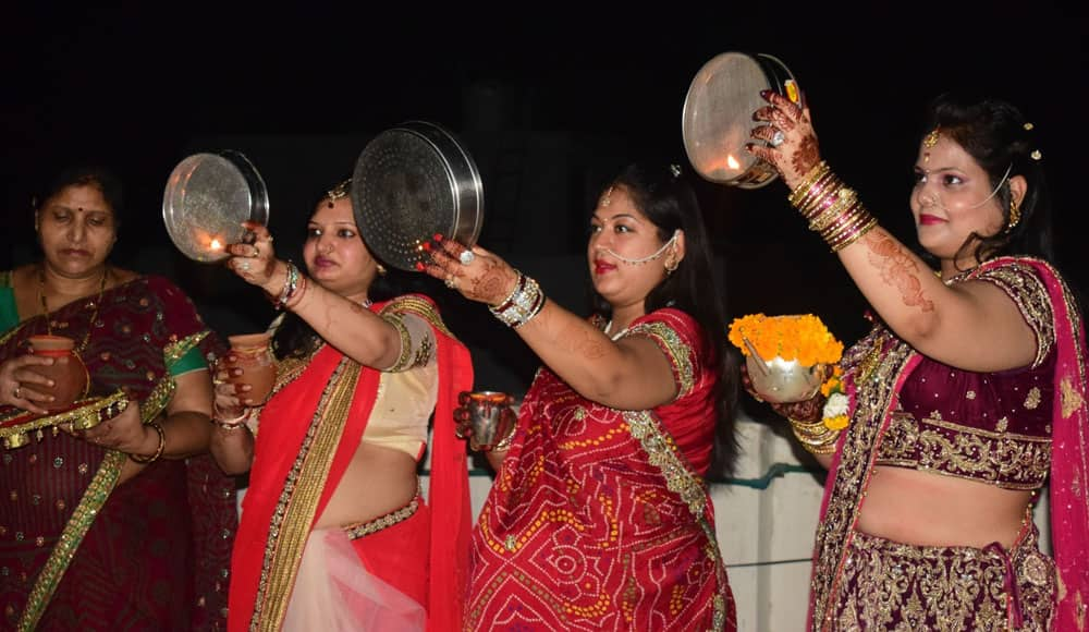 Women celebrate Karva Chauth in Mathura.