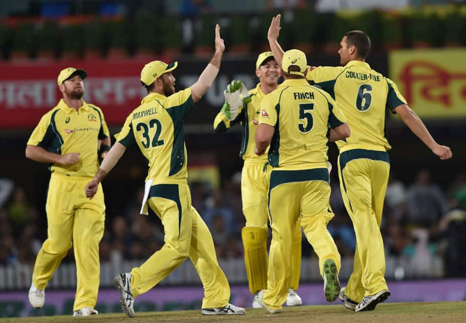 Australian bowler Nathan Coulter-Nile jubiliate with his teammates after dismissed Indian batsman R.Sharma during the 1st T20 cricket match between India and Australia in Ranchi.