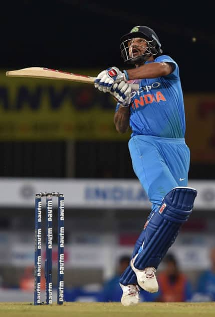 Indian batsman S.Dhawan plays a shot during the 1st T20 cricket match between India and Australia in Ranchi.