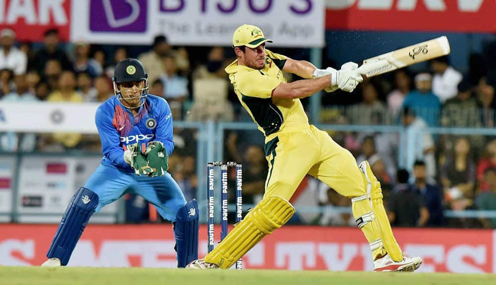 Australian player Moises Henriques plays a shot during their second T20 cricket match against India, in Guwahati.