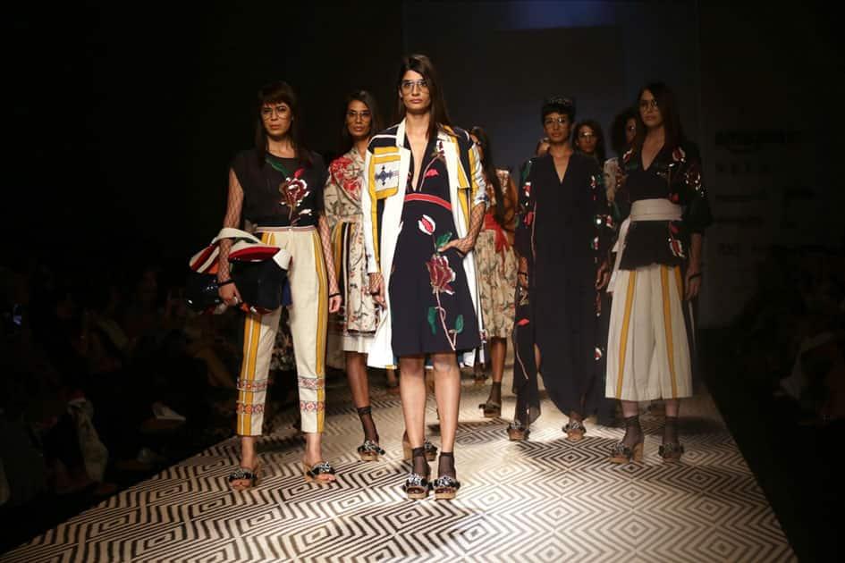 Models walk the ramp showcasing the creations of fashion designer Vineet Bahl at Amazon India Fashion Week Summer Spring in New Delhi.