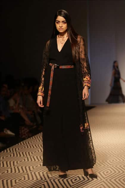 Models walk the ramp showcasing the creations of fashion designer PATINE at Amazon India Fashion Week Summer Spring, in New Delhi.