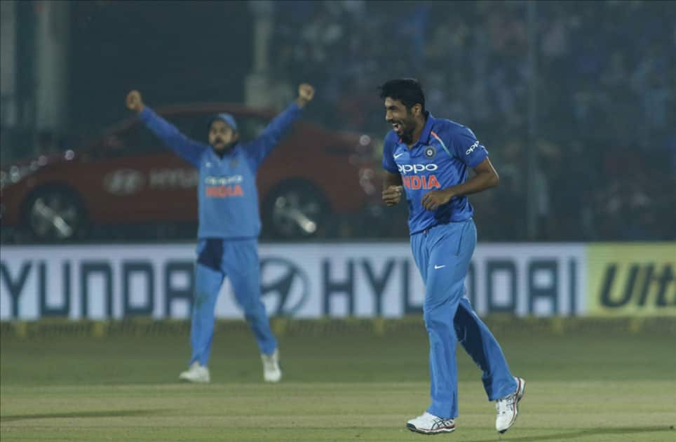 Jasprit Bumrah of India celebrates fall of Ross Taylor's wicket during the third ODI match between India and New Zealand at Green Park Stadium in Kanpur.