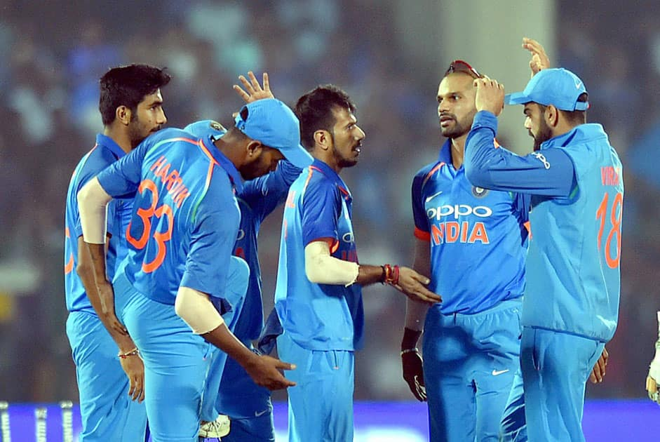 India's Yuzvendra Chahal celebrates the wicket of New Zealand batsman Colin Munro during 3rd ODI cricket match against India at Green Park Stadium in Kanpur.