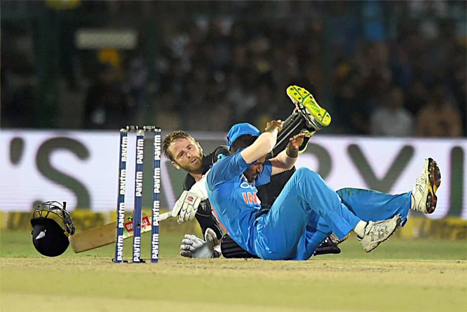 New Zealand batsman Kane Williamson and India's Hardik Pandya falling after a collision during 3rd ODI cricket match against India at Green Park Stadium in Kanpur