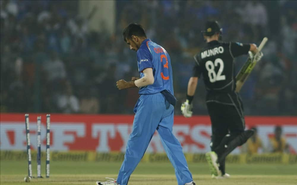 Yuzvendra Chahal of India celebrates fall of Colin Munro's wicket during the third ODI match between India and New Zealand at Green Park Stadium in Kanpur.
