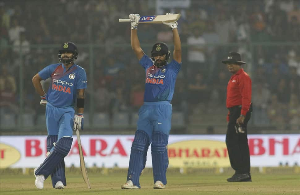 Virat Kohli and Rohit Sharma of India during the first T20 match between India and New Zealand at Feroz Shah Kotla stadium in New Delhi.