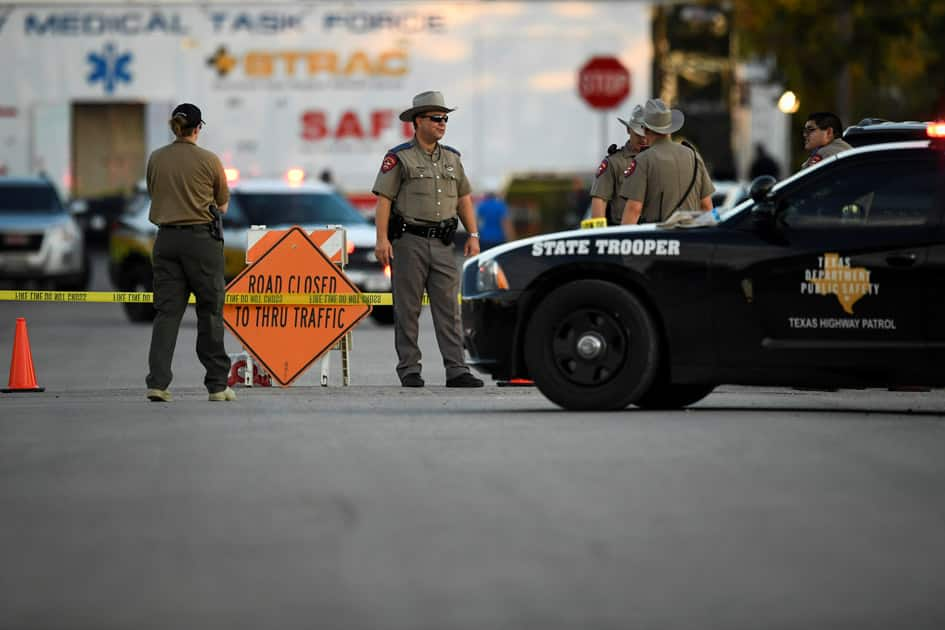 Law enforcement set up along street near First Baptist Church after mass shooting in Sutherland Springs, Texas.