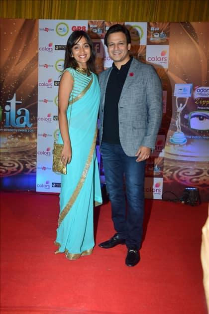 Actor Vivek Oberoi along with his wife Priyanka Alva Oberoi at the red carpet of ITA Awards in Mumbai.