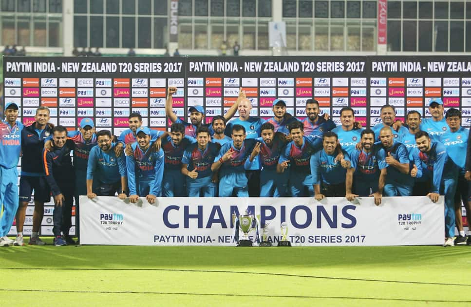 Team India pose with the trophy after winning the T20I series 2-1 during post match presentation ceremony after winning the third and final T20 International match against New Zealand