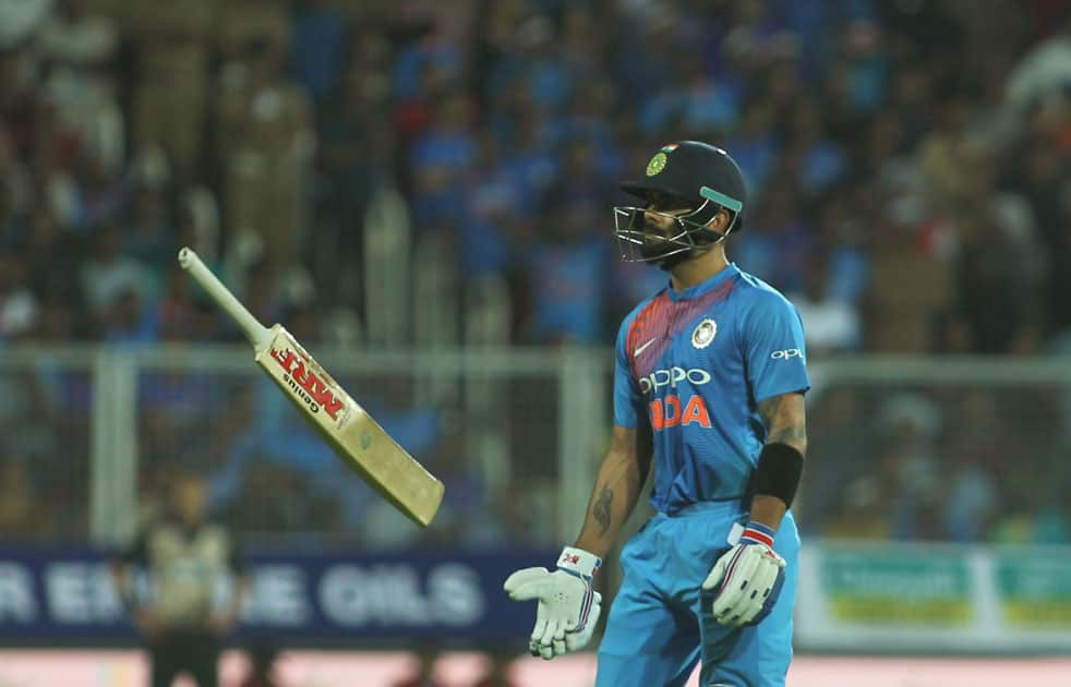 Indian skipper Virat Kohli walks back to the pavilion after getting dismissed during the third and final T20 International match