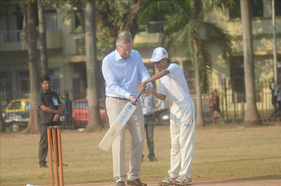 Belgium's King Philippe and Queen Mathilde play cricket with under privileged children during an event hosted by UNICEF in Mumbai.