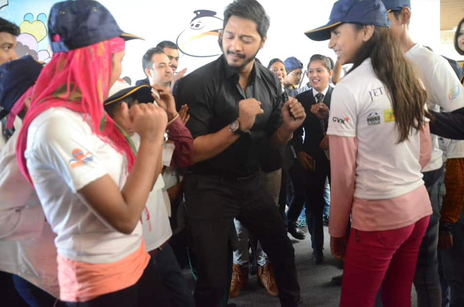 Actor Shreyas Talpade with children during a programme organised to announce 'Flight of Fantasy' by Jet Airways ahead of Children's Day at Chhatrapati Shivaji International Airport in Mumbai.