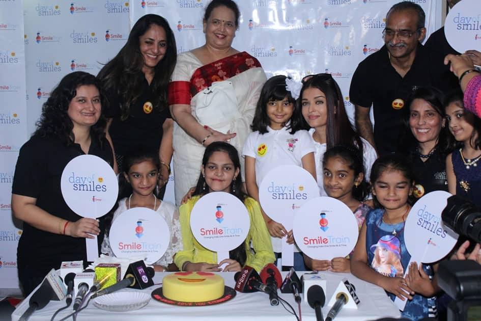 Actress Aishwarya Rai Bachchan along with her mother Brindya Rai, daughter Aaradhya Bachchan and children born with cleft lips and palates of 'Smile Train' celebrates her father Krishnaraj Rai's birth anniversary at Shushrusha Hospital, in Mumbai.