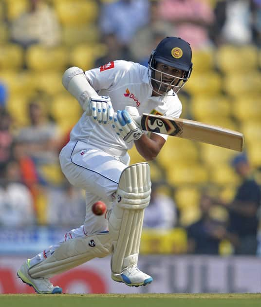 Sri Lankan batsman Dimuth Karunaratne plays a shot during the 2nd test match played against India in Nagpur.