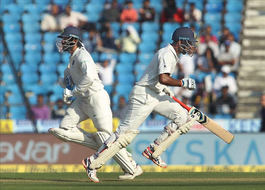 Cheteshwar Pujara and Murali Vijay of India run between the wickets on Day 2 of the second test match between India and Sri Lanka at Vidarbha Cricket Association Stadium in Nagpur.