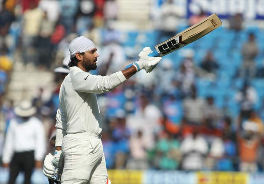 India's Murali Vijay celebrates his century on Day 2 of the second test match between India and Sri Lanka at Vidarbha Cricket Association Stadium in Nagpur.