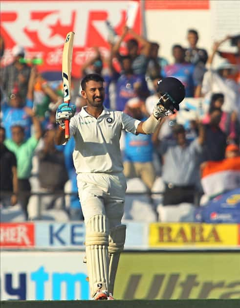 Cheteshwar Pujara of India celebrates his century on Day 2 of the second test match between India and Sri Lanka at Vidarbha Cricket Association Stadium in Nagpur.